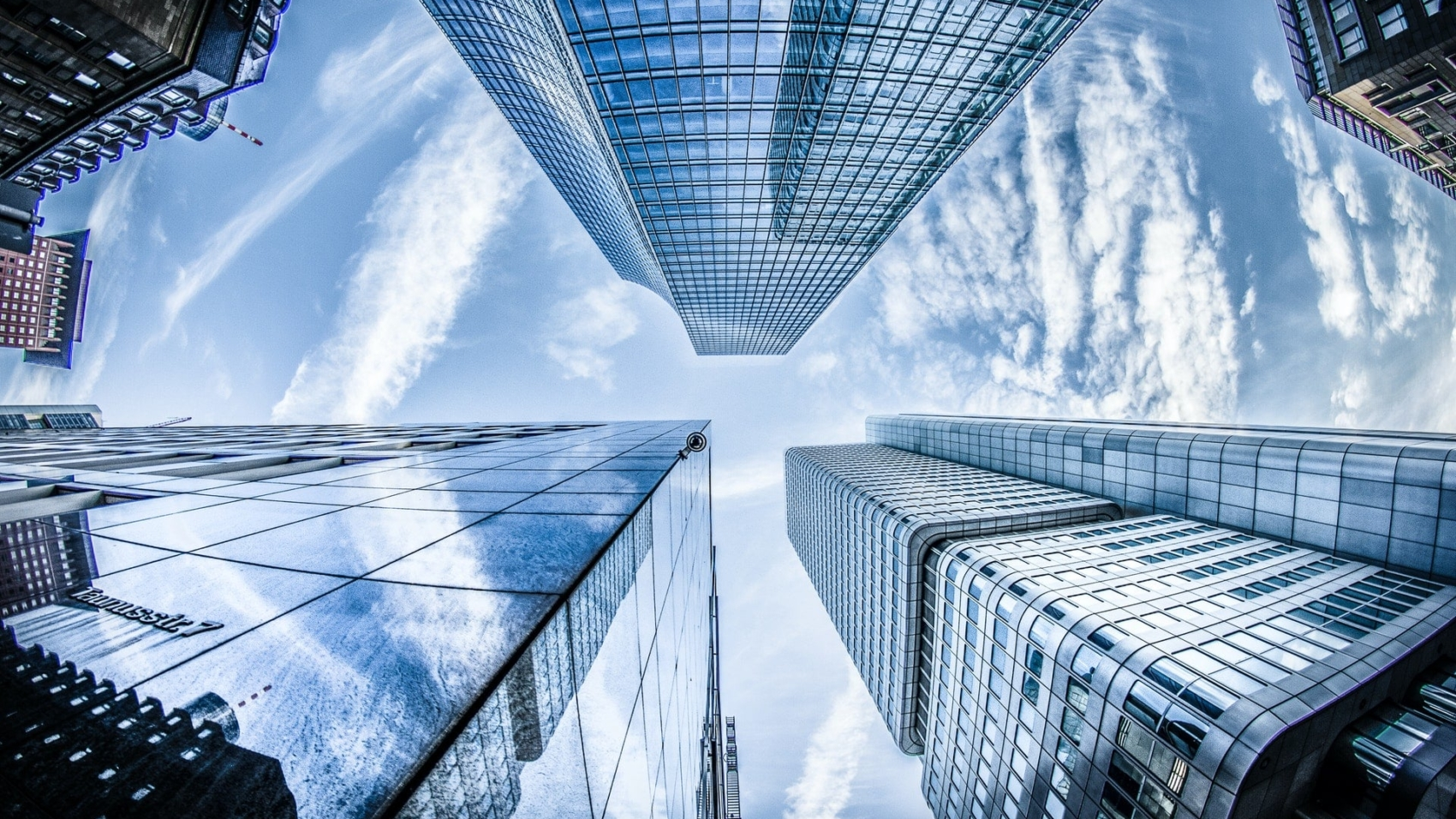 low-angle-photo-of-four-high-rise-curtain-wall-buildings-830891-min
